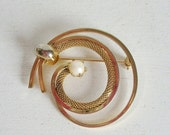 Valentines Day Sale Vintage brooch or pin prong set pearl and gold tone metal braided chain swirl spiral