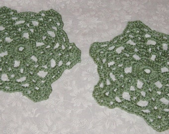 "Two small round Doilies, Green, 5 3/4"" across"