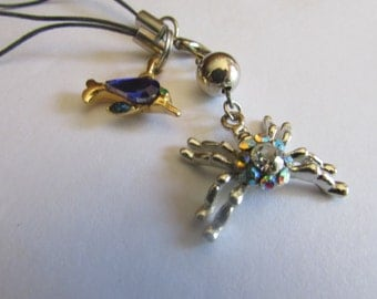 two cell phone charms