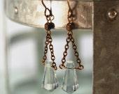 long light blue Czech crystal and natural brass earrings by CURRICULUM