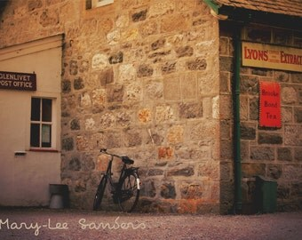 Vintage bicycle in front of the Glenlivet sub post office, Scotland, Highlands