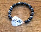 Guitar Pick Bracelet Infinity Love NYC with Black and Silver Wood Beads New York City rocker musician music unisex white travel Manhattan