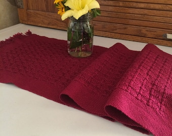 Brick red handwoven table runner in textured lace weave