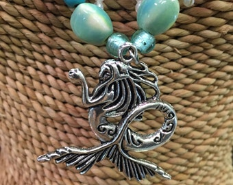 Handcrafted one of a kind mermaid pendant wiith turqoise beading