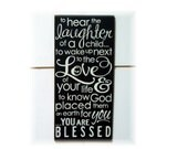 To hear the laughter of a child...you are blessed typography wood sign