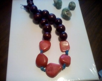 Coral nuggets and natural wood statement necklace.