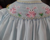 Pale blue hand smocked bishop with 3 bunnies size 3T