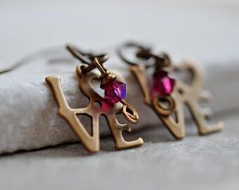 Love Earrings, Love Dangle Earrings, Word Jewlery, Love Jewelry, Word Earrings with Antique Brass Love logo & tiny fuschia Swarovksi Crystal