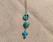 Silver peace, love, and cross necklace