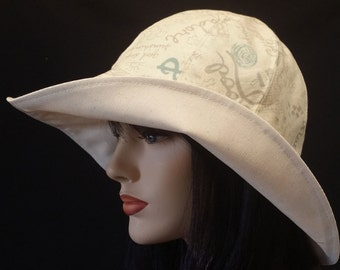 Cottage Hat Wide Brim Sun Hat in neutral natural tones with adjust fit and reversible plus chinstrap