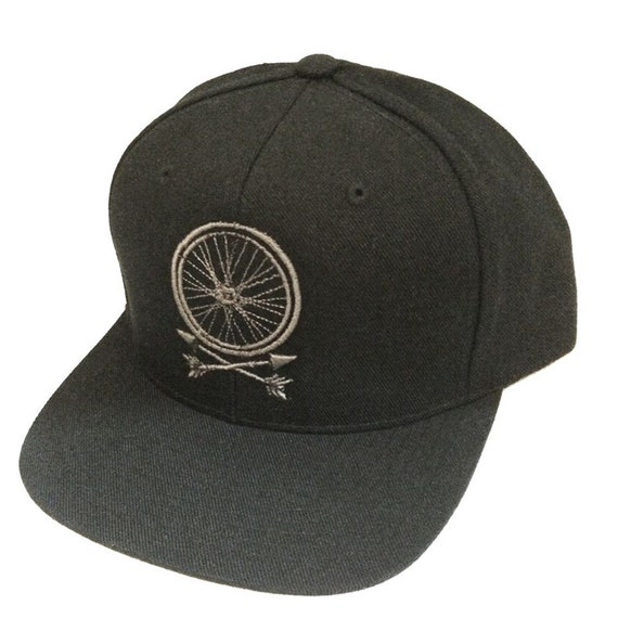 wheel and arrows snapback hat by darkcycleclothing on etsy