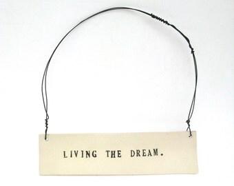 living the dream  ...   inspiring tag   ...   hanging porcelain sign
