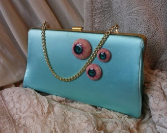 Upcycled Seafoam blue green clutch embellished with handmade eyeballs