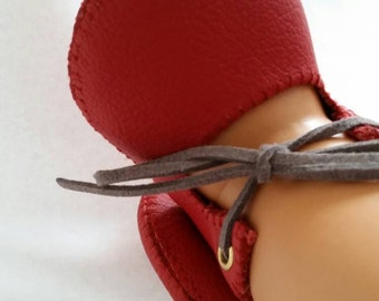 Red leather baby shoes.