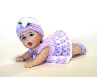 "doll 5"" full porcelain crawling baby cast from a vintage mold and dressed in a crocheted lavender dress"