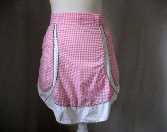 Vintage handmade pink gingham apron with pockets and grey rickrack trim