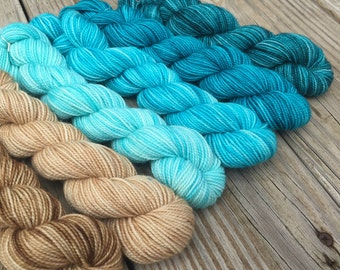 cashmere Floats Your Boat Hand Dyed Gradient Sock Yarn Mini Skein Set 570 yards MCN merino cashmere yarn turquoise teal sandy beach island