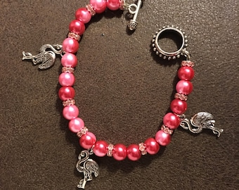 Bracelet , pink two-toned pearls, pink crystal rhondelles, and silver flamingo charms