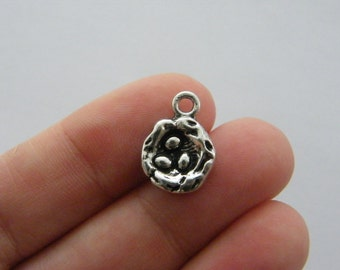 4 Nest charms antique silver tone B143