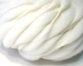 Super bulky and thick and thin, 50 yards and 3 ounces, 85 grams handspun yarn in undyed cream merino wool