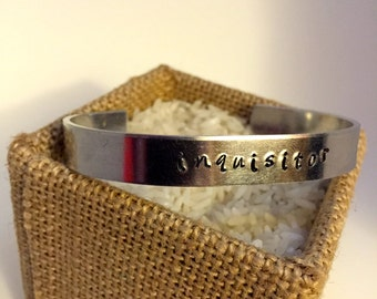 Inquisitor (Dragon Age) hand-stamped cuff bracelet