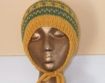Hand knit ear flap hat in warm and cozy yellow and green Wool