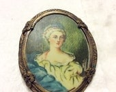 Antique vintage oval cameo style lithograph portrait brooch pin.