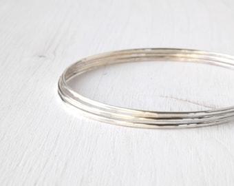 Set of 3 skinny silver bangles bracelets / hammered stacking silver bangles / shiny silver slim hammered bangles /