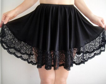 Black mini skirt with lace ruffle. Size S, New