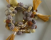 Moroccan art silk bead necklace/bracelet, golden and mustard with mini tassels