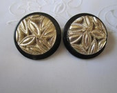 Vintage Black Plastic Clip On Earrings with Shiny Gold Leaf Center Pattern