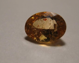 Natural Imperial  Topaz  faceted gemstone ....    9 x 7 x 4.6 mm ...............        B3291