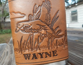 Leather Flask with a Duck in Flight from a Lake.