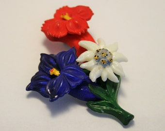 Vintage flower brooch.  Red white and blue