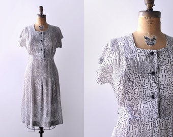 40's silk dress. print. 1940's black & white dress. sheer. patterned. deco. buttons. m.