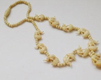 Vintage Hand Carved Bone beaded Elephant Necklace