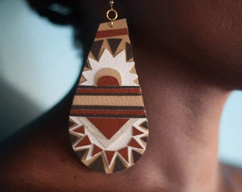 hand cut desert inspired geometric x polyurethane earrings.