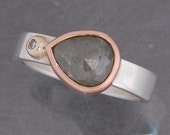 Grey, pear shaped, rose cut diamond ring in 14 karat rose gold, yellow gold and sterling silver
