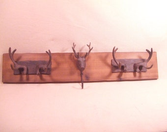 Rustic Cast Iron  Stag heads and Deer Antler coat rack  - lodge cabin decor - rich patina  cast iron hooks and burnished western cedar
