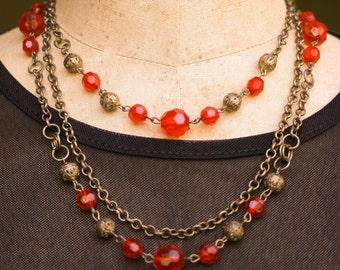 Orange Bead Triple Strand Necklace