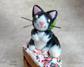 Frosted Cake Kitty Fairy - A tuxedo cat fairy with green wings