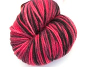 Variegated red and black hand-dyed worsted weight yarn   Round Table Yarns Lancelot in Quest colorway