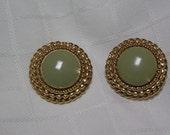 St. John's circular green glass in triple braided gold edges clip earrings