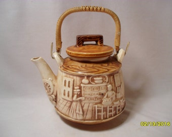 Sweet Decorative Ceramic Teapot with Raised Scene Pattern and Wicker Handle