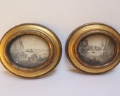 Pair of Antiqued Gold GIlt Oval Framed Prints of Ships in Port (2) pictures