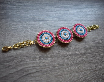 Turquoise, white, and coral circle bracelet