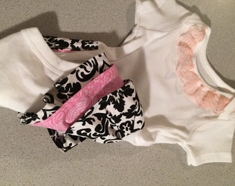 All in one with pink and black and white ruffles Size 0-3 months
