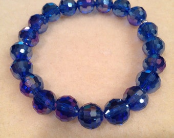Sapphire Blue Iridescent Faceted Crystal Glass Bead Stretch Bracelet with Sterling Silver Accent