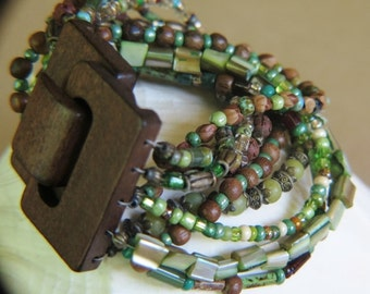 Multiple Strand Beaded  Bracelet -Wooden Clasp -  - Wide range  of beads - wooden glass mother of pearl and more