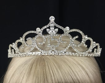 Vintage Secret Rhinestone Garden Quinceanera Tiara with sparkling detail! Feel like a princess while celebrating 15 years of age!